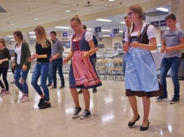 German cultural exchange students teach their American hosts some new dance steps in the Penn Manor High School cafeteria.