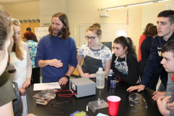 image Pitt Researcher Dr. David Boone works with BPHS biology students on a DNA lab experiment.