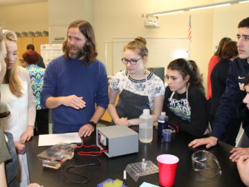 Biology students perform DNA analysis working alongside cancer researchers