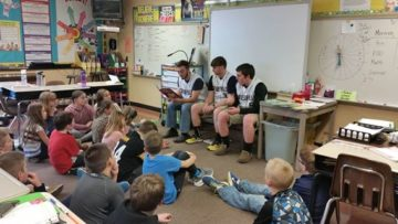 Members of the Curwensville Golden Tide's baseball team read a story to Mrs. Coudriet's fourth-grade class.