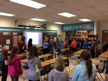 Spanish Club members help elementary students welcome new classmate