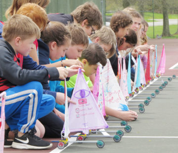image of students launching sailboats
