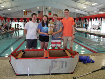 Cardboard boat races teach tradition and physics