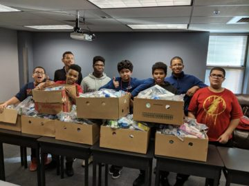 Young men collect items for hurricane victims