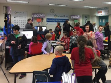 Woodland Elementary students assist Mrs. Burgess during STEM Lab Open House