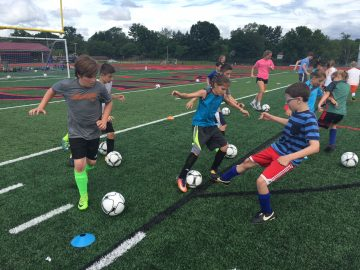 PWHS boys' and girls' soccer teams worked together to help more than 140 younger children develop their skills.