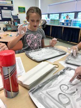 students practice kinesthetic spelling skills