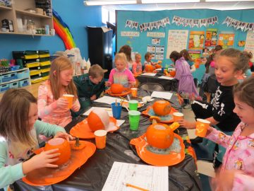 Gill Hall second-graders create pumpkin volcanoes while learning about chemical reactions