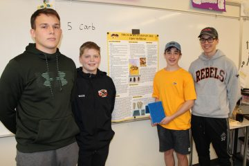 Four of Mr. Winschel's students with their honey bee poster and 3D bee hive model