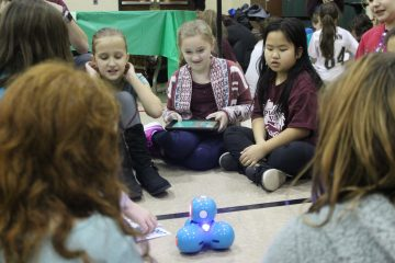 Girls from Pleasant Valley Elementary work together to code Dash.