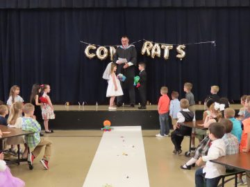 Gill Hall kindergartners celebrate the marriage of 'Q' and 'U'
