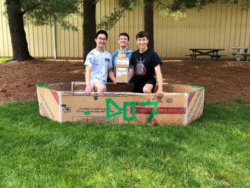 Physics students compete in cardboard boats for the Benner Cup