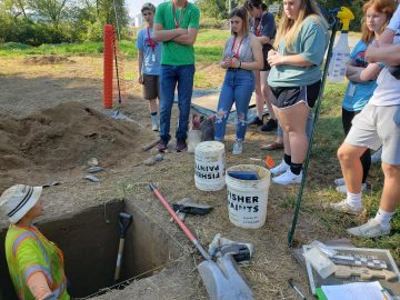 High school students visit archeology dig site