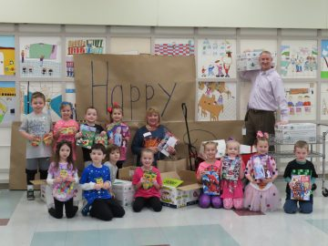 McClellan kindergartners celebrate 100th day of school with donation to Beverly's Birthdays